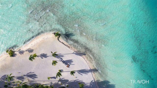 Amazing Drone View - Motu Tane Private Tropical Beach - Bora Bora Sea - French Polynesia - 4K Travel Video